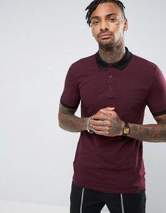 Read more about Asos muscle fit polo shirt with contrast rib and cuff in red - kidney black