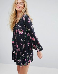 Read more about Asos button through mini swing dress with trumpet sleeve in floral print - multi