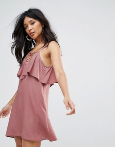 Read more about Glamorous dress with lace up ruffle front - mauve
