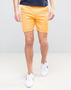 Read more about Asos slim chino shorts in bright yellow - beeswax