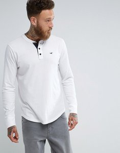 Read more about Hollister long sleeve top henley icon logo slim fit in white - white