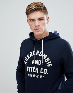 Read more about Abercrombie fitch large front flock logo hoodie in navy - navy