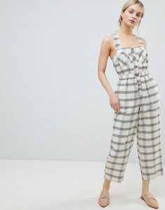Read more about Asos design jumpsuit with elasticated waist and button detail in check - ivory check