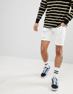 Read more about Asos design denim shorts in skinny white with heavy rips - white