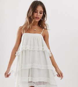 Read more about White sand tiered mini dress in ivory