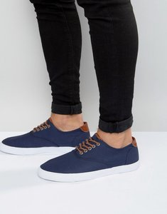 Read more about Asos lace up plimsolls in navy with tan trims - navy