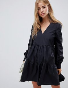 Read more about Asos design tiered cotton smock mini dress with long sleeves - black