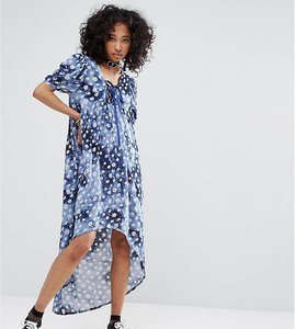 Read more about Milk it vintage lace up dress in ditsy tie dye floral - multi