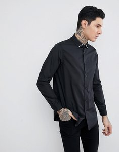 Read more about Asos regular fit longline shirt with star studs - black