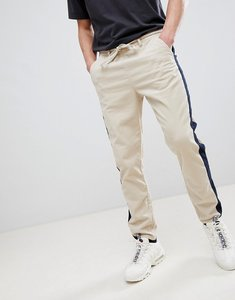 Read more about Asos design tapered trousers in putty cord with navy side stripe - putty