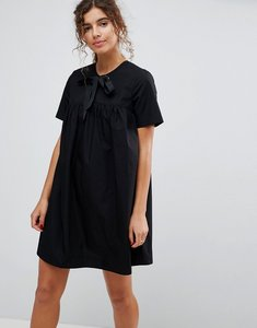 Read more about Asos smock dress with eyelet detail and grosgrain tie - black