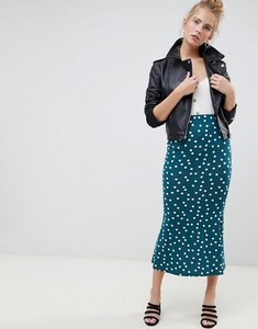 Read more about Asos design midi skirt with kickflare in polka dot print - forest green white