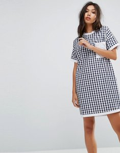 Read more about Uncivilised mix check tee dress