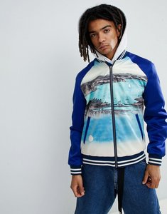 Read more about Asos design varsity bomber jacket with print in blue - blue