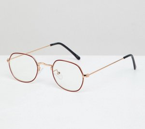 Read more about Asos design angled round glasses in gold with red edge detail clear lens - gold