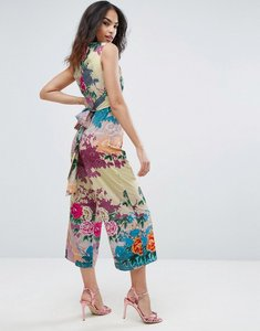 Read more about Asos jumpsuit with wrap front and tie back in floral print - multi floral