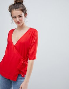 Read more about Monki wrap front blouse in red - red