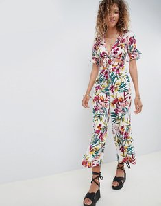 Read more about Asos design tea jumpsuit with cut out and tie detail in tropical print - tropical print