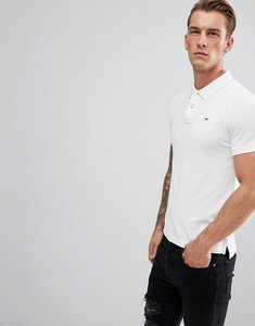 Read more about Tommy hilfiger denim polo slim fit with flag logo - white
