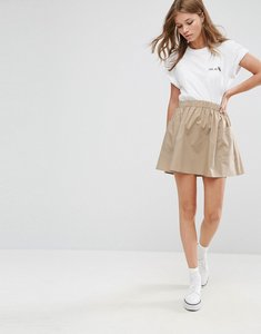 Read more about Asos mini skater skirt in cotton poplin with pockets - stone