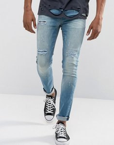 Read more about Asos super skinny jeans in vintage mid wash blue with rip and repair detail - mid wash vintage