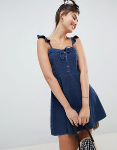 Read more about Asos design denim mini dress with frill strap detail - blue