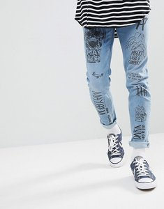 Read more about Asos design skinny jeans in mid wash blue with all over grunge prints - mid wash blue