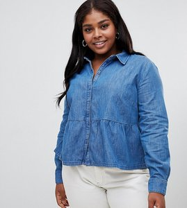 Read more about Asos design curve denim shirt with ruffle hem in midwash blue - blue