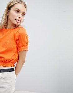 Read more about Asos design crop t-shirt with shirred hem and cuffs - bright orange
