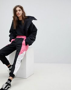 Read more about Asos track pant with colour block side panels - black