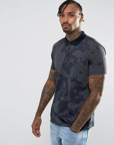 Read more about Asos polo shirt in camo print and heavy wash - khaki