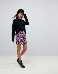Read more about Asos denim mini skirt in pink zebra print - pink