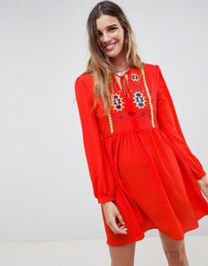 Read more about Glamorous smock dress with tassle ties and embroidery - red