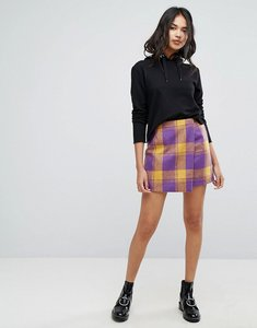 Read more about Prettylittlething check wrap mini skirt - purple