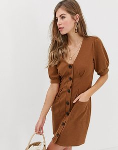 Read more about Asos design puff sleeve textured dress with faux horn buttons