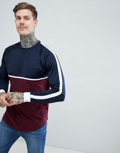Read more about Asos design relaxed longline long sleeve t-shirt with contrast yoke in woven fabric and curved hem i