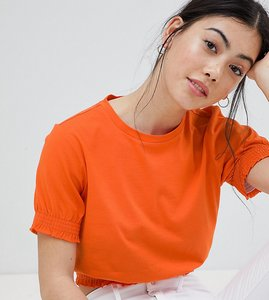 Read more about Asos design petite crop t-shirt with shirred hem and cuffs - bright orange