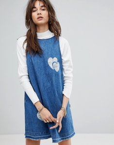 Read more about Love moschino distressed pinny denim dress - blue