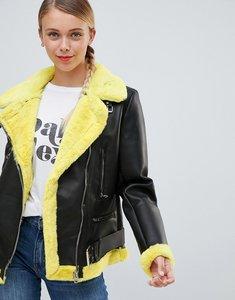 Read more about Bershka faux fur contrast biker jacket - yellow