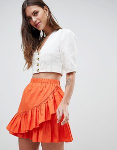 Read more about Asos design cotton mini skirt with wrap detail - burnt orange