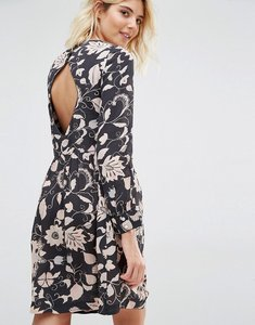 Read more about Gat rimon moco open back long sleeve flower print dress - noir