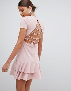 Read more about Prettylittlething lace up back detail frill hem dress - pink