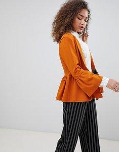 Read more about Parisian peplum hem jacket - tan