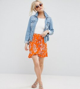 Read more about Asos petite wrap mini skirt with tie waist in ditsy print - orange