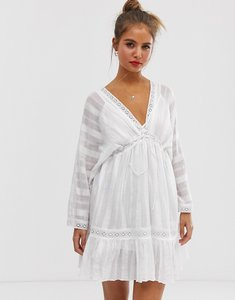Read more about Asos design lace insert mini smock dress with lace up detail