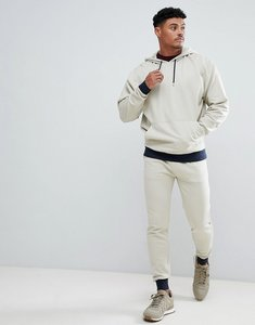 Read more about Asos design tracksuit oversized hoodie skinny joggers with contrast cuff in beige and navy - noodle
