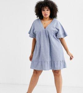Read more about Asos design curve v front v back smock mini dress in chambray