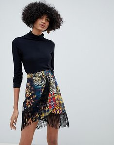 Read more about Asos design mixed check print wrap mini skirt with fringing - multi
