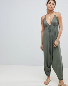 Read more about Asos design jersey jumpsuit with drop crotch and harem pant - khaki