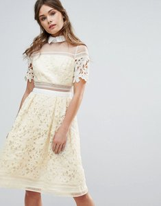 Read more about Chi chi london premium lace panelled dress with contrast collar - lemon